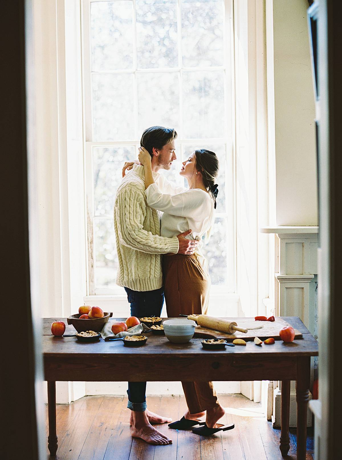 charleston elopement photography adventure on film with bride and groom in kitchen making pies
