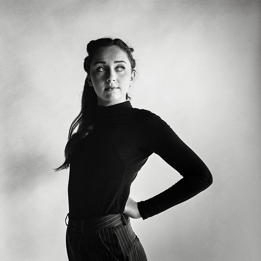 black and white film studio portrait of girl in black turtleneck at studio sixty reid with kodak tri-x pushed film