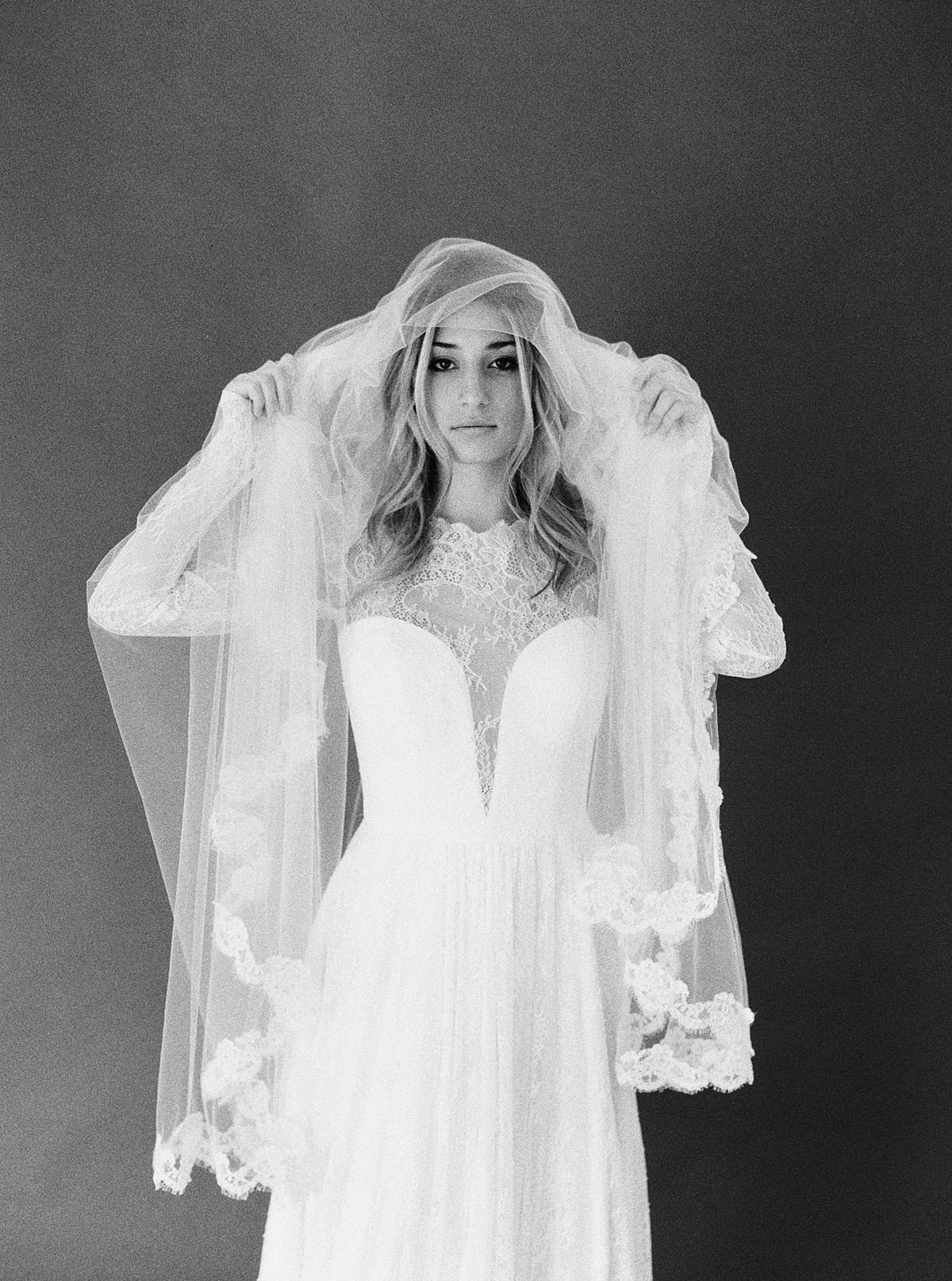 studio bridal portrait in charleston sc by brian d smith photography on ilford delta 3200 medium format film with lace veil overhead