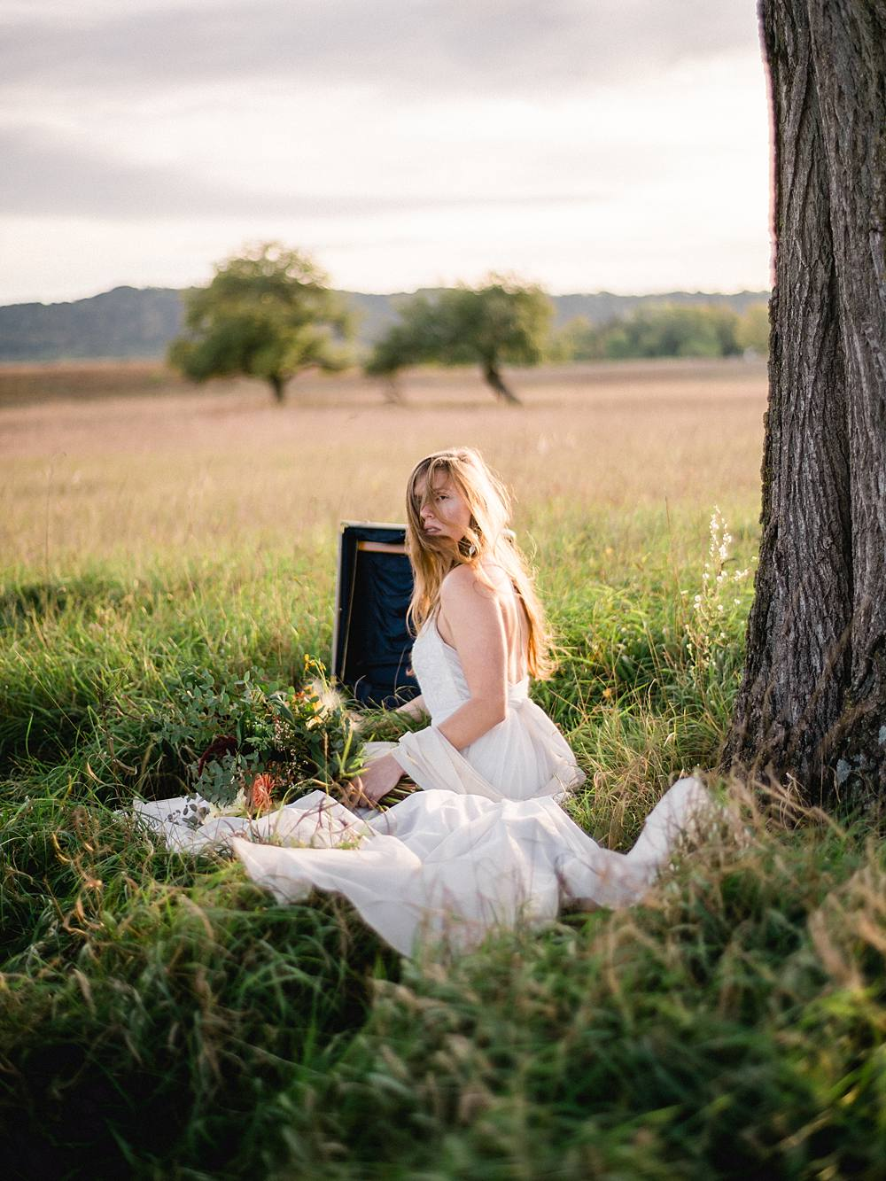 northern michigan bride in a field photographed by michigan wedding photographer brian d smith photography on kodak film