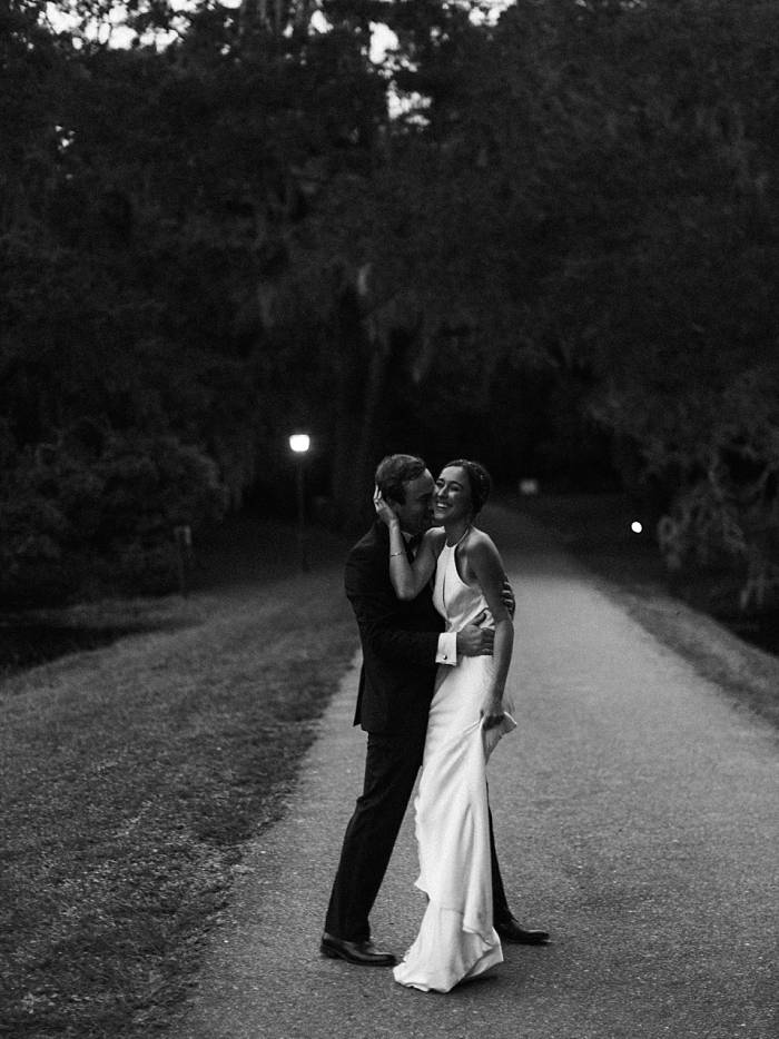 documentary photography black and white portrait of bride and groom dancing at charleston wedding venue legare waring house