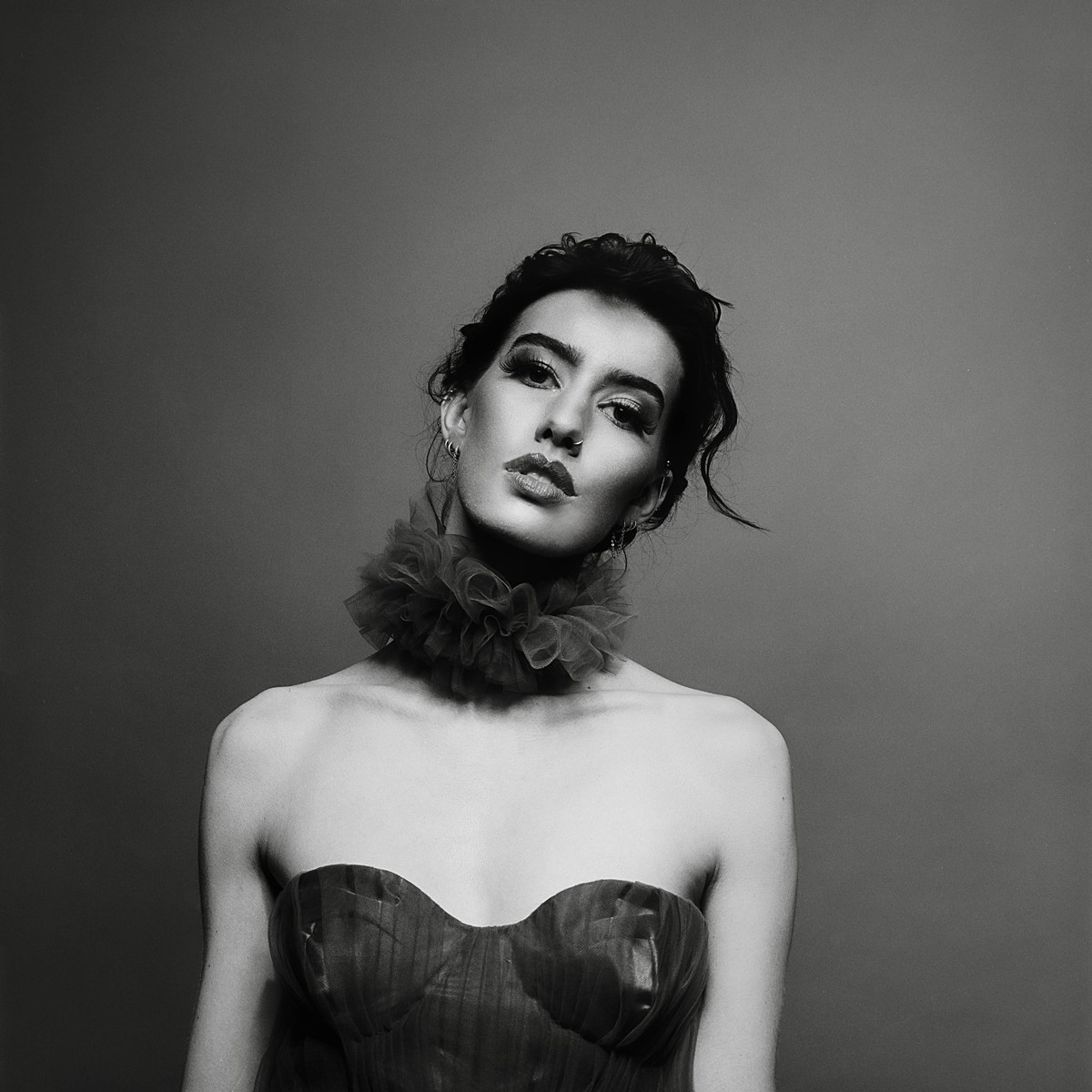 black and white studio fashion portrait a la richard avedon on kodak tri-x 400 film and hasselblad 202fa