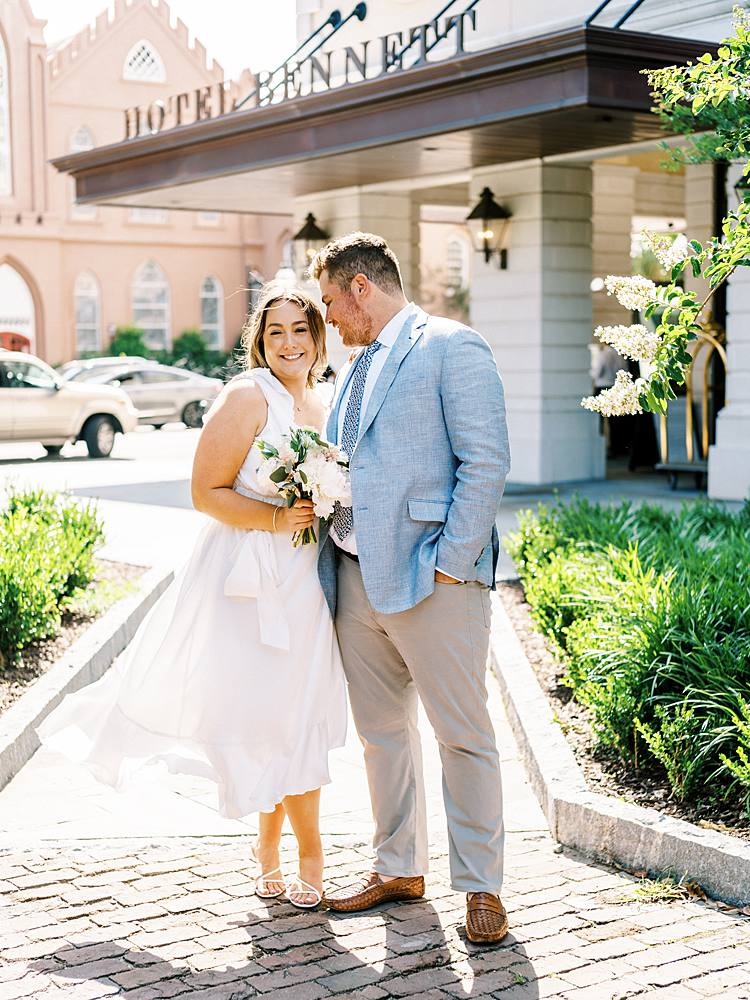 35mm film portrait of bride and groom in front of charleston sc wedding venue hotel bennett