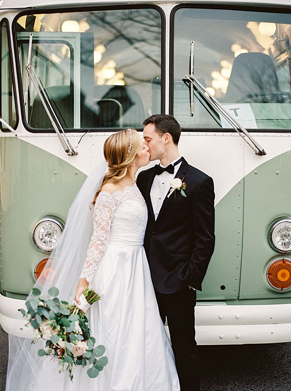 lowcountry vintage bus transportation with bride and groom in front for film portrait at a william aiken house charleston wedding in february