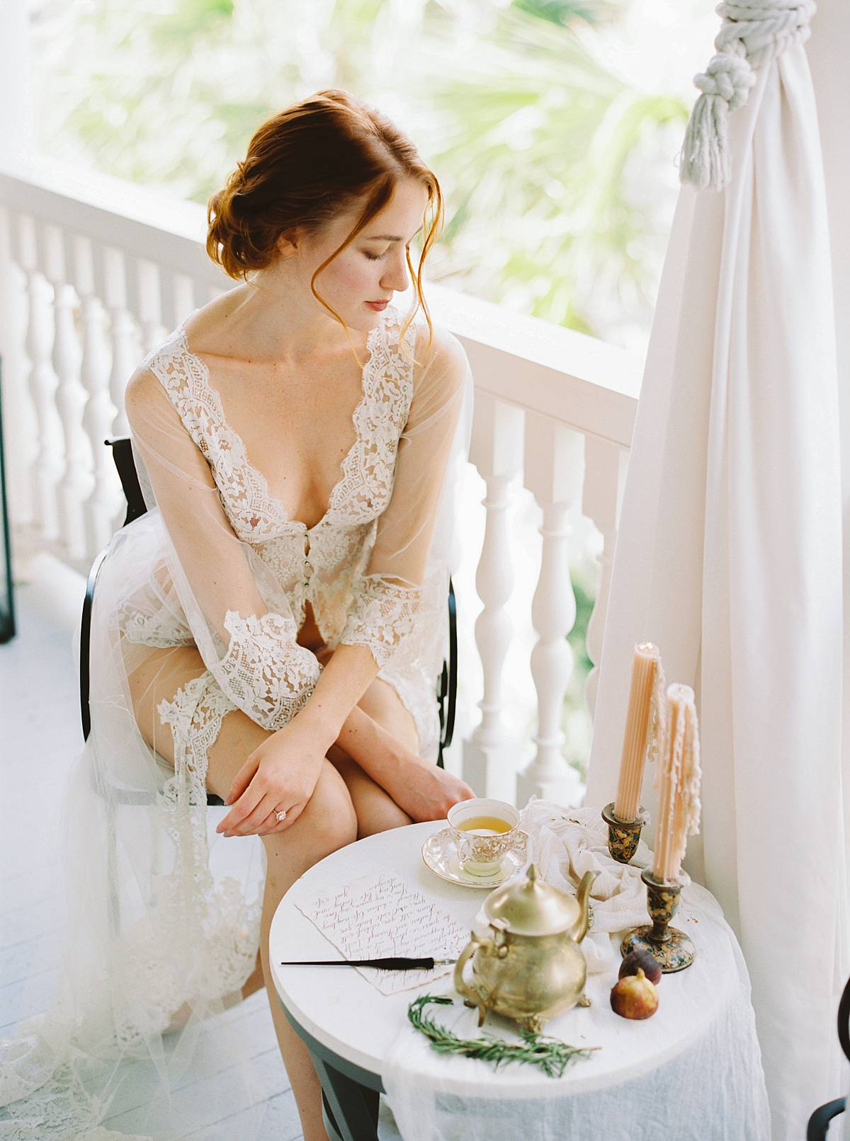 charleston wedding bridal boudoir morning getting ready at 86 cannon street on film with bride in lingerie writing love letter
