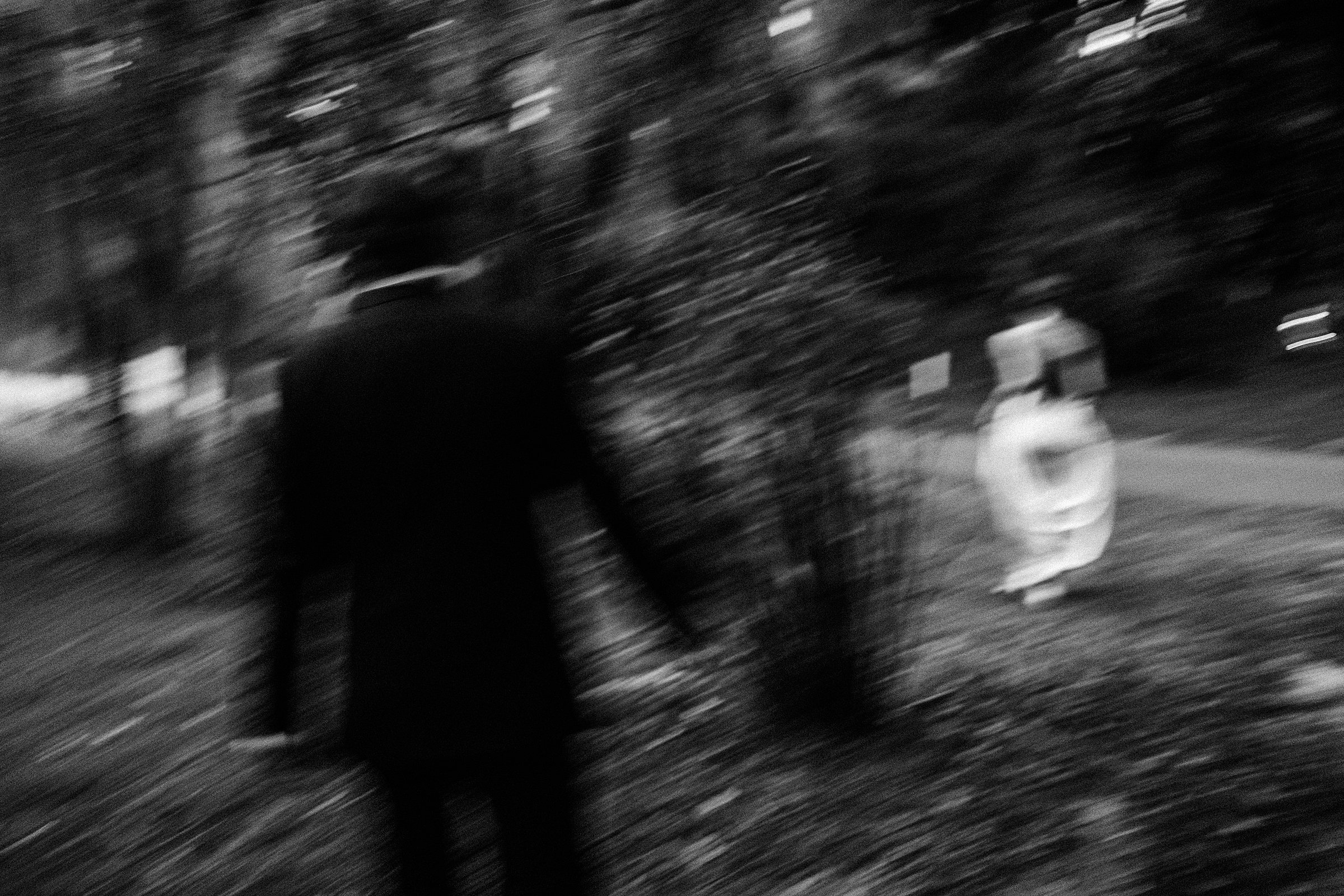 blurry black and white image of bride and groom walking at charleston sc wedding at legare waring house