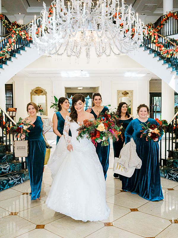 charleston wedding bridal party walking through the belmond charleston place hotel lobby