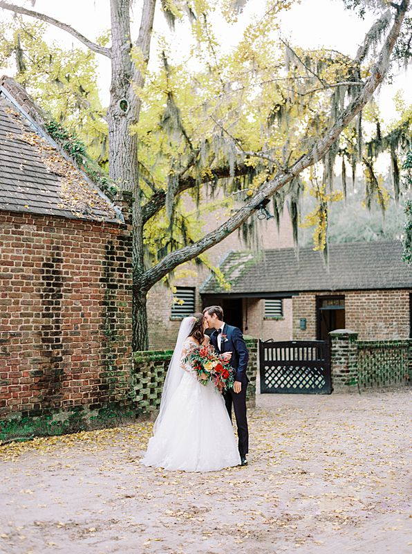 fall middleton place wedding portrait on kodak portra 800 film in charleston south carolina with blooming yellow tree and colorful bouquet