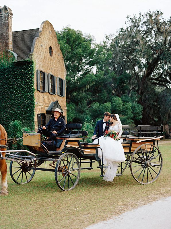 bride and groom on carriage in front of inn at middleton place in charleston south carolina by film wedding photographer brian d smith