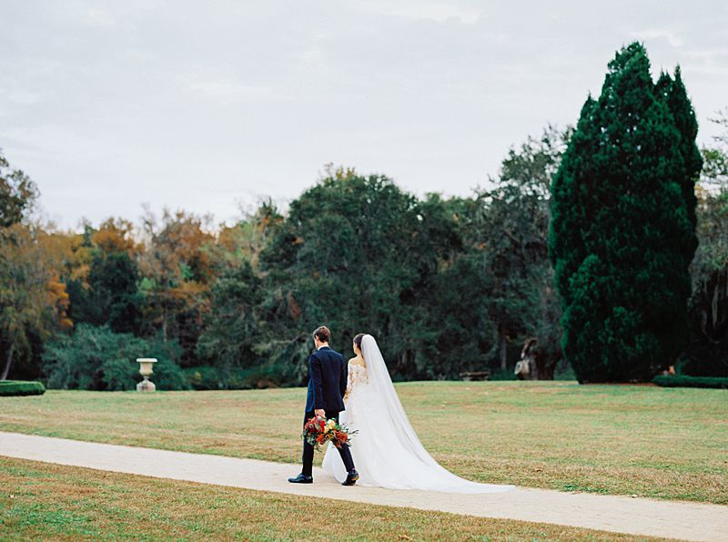 middleton place charleston wedding venue with fall colors and bride and groom walking on kodak portra 800 film