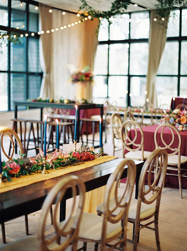 jewel tone tablescape at charleston sc wedding venue middleton place during reception