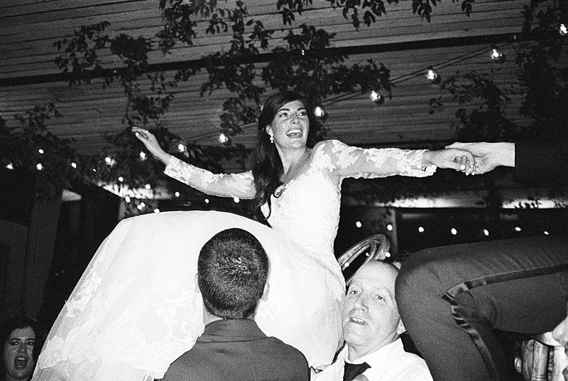 bride and groom dancing the horah at middleton place on kodak p3200 35mm film