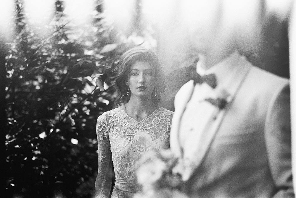light leak 35mm film image from leica m-a of bride and groom in charleston sc wedding editorial