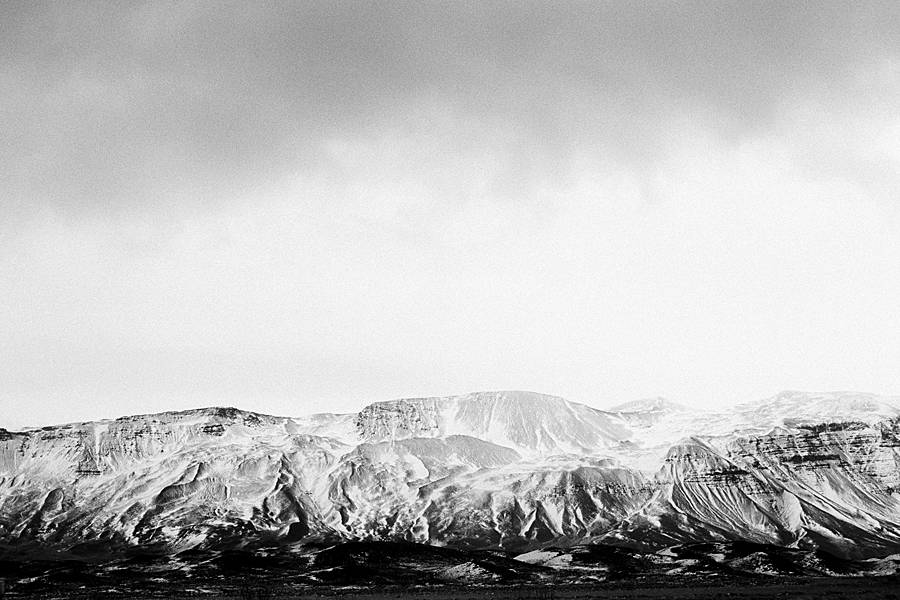 snow covered iceland mountain on grainy black and white kodak tri-x 400 35mm film pushed 2 stops at 1600