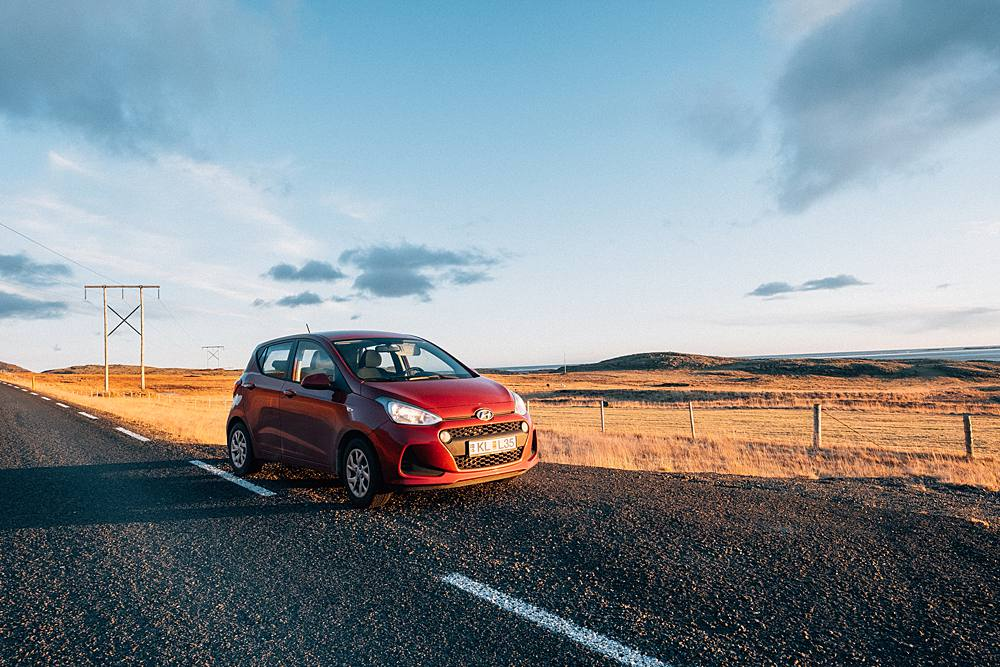 red hyundai i10 in iceland ring road during novemeber with fuji xt2